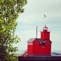 Photo taken at Holland State Park by Oscar D. on 5/26/2013