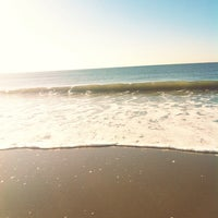 Photo taken at 12th Street Beach by Josh K. on 9/5/2013