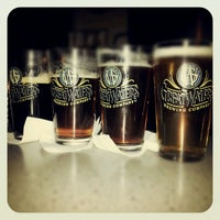 Photo taken at Great Waters Brewing Company by Jessica S. on 11/15/2012