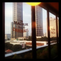 Photo taken at The New Magnum Café by Kelvin H. on 5/4/2013
