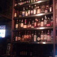 Photo taken at Miracle of Science Bar & Grill by oscar g. on 2/21/2013