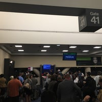 Photo taken at Gate 41 by Tom C. on 6/7/2016
