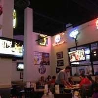 Photo taken at Pluckers Wing Bar by Brenda N. on 5/26/2013