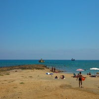 Photo taken at Pernera Beach by Артём Н. on 6/26/2013