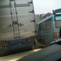 Photo taken at Indomaret Caman by Riris H. on 10/12/2012