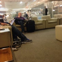 Photo taken at Delta Sky Club Lounge by Flaviano L. on 3/2/2014