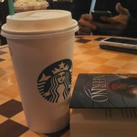 Photo taken at Starbucks by Julio A. on 6/14/2013