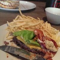 Photo taken at Gourmet Burger Kitchen by Edward B. on 3/13/2014