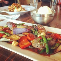 Photo taken at Mini Mango Thai bistro (New name: Mango on main) by Kevin H. on 7/12/2015