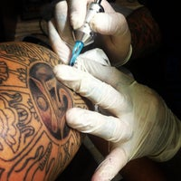 Photo taken at Wild Ones Tattoo by vic n. on 4/17/2013