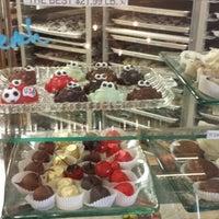 Photo taken at Riverside Chocolate Factory by Sarah G. on 7/7/2014
