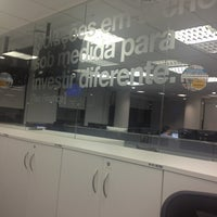Photo taken at XP Investimentos by Marcio C. on 8/12/2013