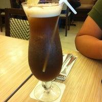 Photo taken at Sérye Café Filipino by Christine Y. on 4/25/2014