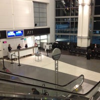Photo taken at Gate A11 by Eric A. on 12/8/2012