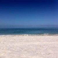 Photo taken at Vanderbilt Beach by Stephen L. on 5/3/2013