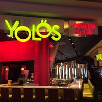 Photo taken at Yolös Mexican Grill by Mark L. on 4/4/2015