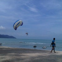 Photo taken at Batu Ferringhi Beach by Elaina R. on 11/3/2012