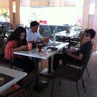 Photo taken at Tamani Kafe by Wanda M. on 9/7/2014