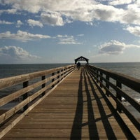 Photo taken at Waimea Recreation Pier by Lourdes L. on 1/6/2014