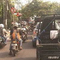 Photo taken at Lampu merah relasi by Putu Ayu F. on 3/27/2013