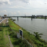 Photo taken at 飯塚橋 by Ryoichi T. on 9/14/2013