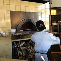 Photo taken at Olio Wood Fired Pizzeria by Lawton H. on 9/26/2012