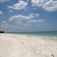 Photo taken at Bonita Beach by Christina C. on 4/25/2013
