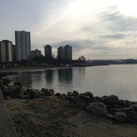 Photo taken at English Bay Beach by Daniel on 1/1/2013