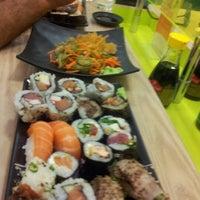 Photo taken at Kantô Sushi Express by E Я L O N M. on 1/19/2013