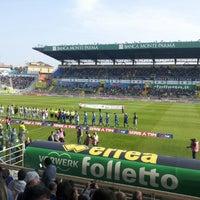 Photo taken at Stadio Ennio Tardini by Fabio M. on 10/21/2012