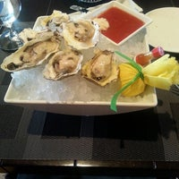 Photo taken at Oyster Bar at M Resort by Kaleena Luna W. on 6/23/2013