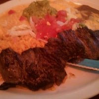 Photo taken at Amigos Mexican & Spanish Restaurant by Amanda N. on 6/1/2012