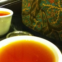 Photo taken at Teahouse Kuan Yin by Whitney C. on 1/30/2012