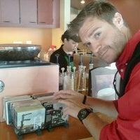 Photo taken at Starbucks by Neil on 10/26/2011