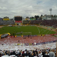 Photo taken at Estadio Olimpico Atahualpa by Sebastian V. on 10/2/2011
