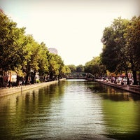Photo taken at Canal Saint-Martin by Sandro S. on 8/21/2012