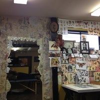 Photo taken at Love and Hate Tattoo & Body Piercing by Levi R. on 12/12/2012