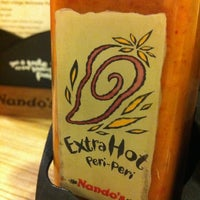 "Photo taken at Nando's by Adrian ""Dogg"" C. on 10/13/2012"
