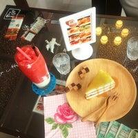 Photo taken at Lomo Cafe'' by Faii H. on 9/15/2013