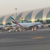 Photo taken at Dubai International Airport (DXB) by Redha A. on 6/26/2013