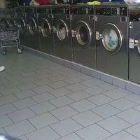 Photo taken at Brooklyn Bubbles Laundromat by Felipe F. on 10/5/2011