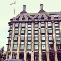 Photo taken at Portcullis House by Su B. on 9/26/2013