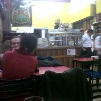 Photo taken at Pizzeria Mi Tio by Luis V. on 6/16/2013