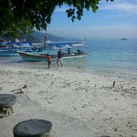 Photo taken at Pantai Mutun by Dody G. on 6/28/2013