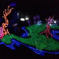 Photo taken at Putting Edge Glow-in-the-Dark Mini Golf by Ashley M. on 2/22/2014
