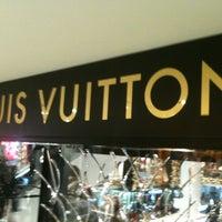 Photo taken at Louis Vuitton by Ariel C. on 1/2/2013
