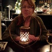 Photo taken at Hazraj by John G. on 12/12/2012