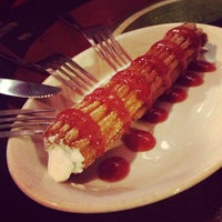 Photo taken at Churros Calientes by Mike P. on 2/7/2013