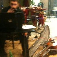 Photo taken at Wired Coffee House & Music Venue by Chukk N. on 12/15/2011