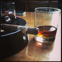 Photo taken at Cigar Bar & Grill by M K. on 7/19/2013